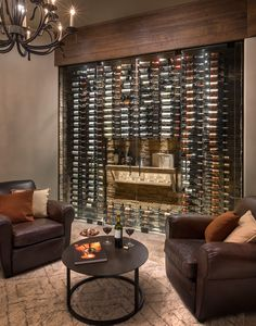 Introducing our latest project! A rustic wine showcase that brings the ambiance and feel of being at a lodge or resort!  See yourself sitting in front of this showcase, sipping on a favorite glass of wine while enjoying the view of your favorite wine collection.--  Amazing, right?! #winecellarexperts #winecollection #wineshowcase