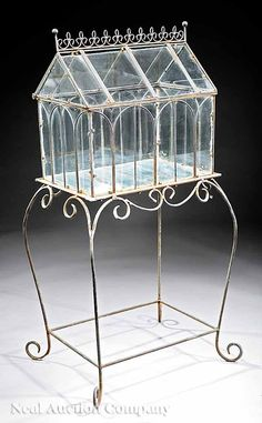 """Sold For $725  An Architectural Wirework """"Wardian Case"""" on Stand , early 20th c., crenelated crest, scrolling wrought iron base, height 42 1/2 in., width 20 in., depth 14 1/2 in"""
