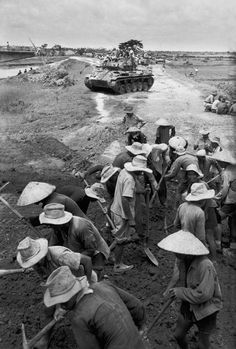 ---INDOCHINA. First Indo-Chinese War. Don Qui Thon. Vietminh prisoners replace bridges destroyed by a Vietminh attack. May, 1954.---Robert Capa. click image for source...