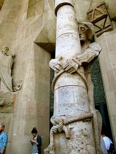 Tourists browse the Sagrada Familia, unaware of the weight of the artist's message. - Danica Wixom by APIstudyabroad, via Flickr