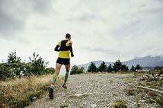 05a1b4d4d male runner in compression socks and backpack running a mountain marathon  on a blue sky background - Buy this stock photo and explore similar images  at ...