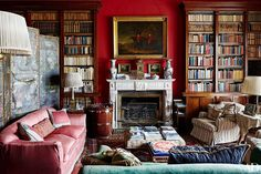 The library's marble mantel hosts a circa-1840 French clock; the Gothic Revival brass-bound bucket was designed to hold turf, a traditional Irish fireplace fuel. At far left is an 18th-century chinoiserie leather screen that is English or Dutch in origin.