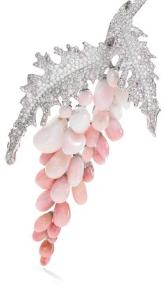 Conch pearl and diamond-demi-parure and ring Comprising: a necklace of torque design, pavé-set with brilliant-cut diamonds to the front, suspending a wisteria motif set with conch pearls of graduated pink hues, the leaves pavé-set with diamonds of pink and near colourless tint, inner circumference approximately 370mm, maker's mark, numbered; and a pair of earrings of similar design, set with conch pearls, briolette and brilliant-cut diamonds, post and clip fittings; and a ring