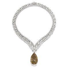 CARTIER Impressive Fancy Deep Brown-Orange Diamond Pendant; with Diamond Necklace, Cartier | Lot | Sotheby's