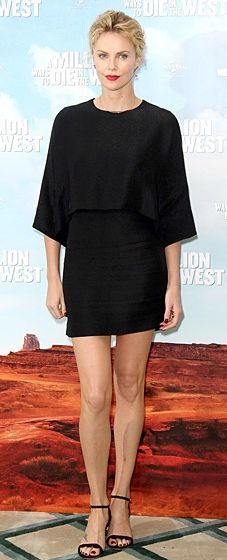 """Charlize Theron shows off her legs in a black Stella McCartney dress to the London photocall for """"A Million Ways to Die in the West"""""""