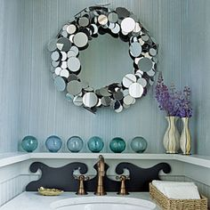 2010 Ultimate Beach House: Seabrook:  I love the seaglass color, the unique detail behind the faucet, and that wonderful mirror that reflects light in every direction.