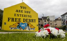 (Aug 02 2020) Flowers and a message to the late John Hume rest below a Free Derry Corner in the Bogside of Derry City that shows Hume and others important figures during the movement. The Former SDLP leader, who was one of the key architects of peace in Northern Ireland, has died at the age of 83. (Photo by Liam McBurney/PA Images via Getty Images)