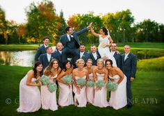 The Wedding Party having some fun on the Green! Wedding Photography by Carrington Creative Photography