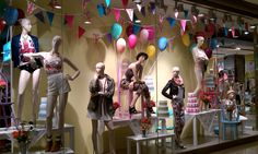Mannequins on the window display in the fashion shop. Great example of visual merchandising.