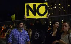 """Thousands of demonstrators took to the streets in several US cities for a second night of nationwide protests on Thursday over the stunning election of Donald Trump to the presidency. Trump, commenting on the unrest for the first time, blamed the news media. Shouting """"Not my president!"""" and carrying placards that read """"I did not"""