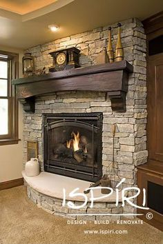 Fireplace has a custom Indiana Limestone hearth and stone