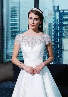 Silk dupion ball gown adorned by a Sabrina neckline