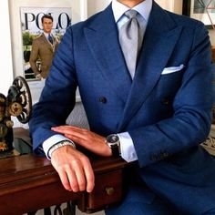 Double breasted blue suit and glen plaid tie in charcoals.