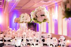 Tall floral centerpieces at classic wedding reception at Nanina's In the Park
