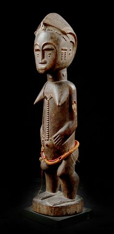 Africa | Female figure from the Baule people of Ivory Coast | Wood and glass beads