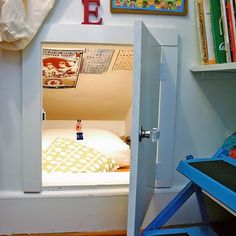 A low-ceiling crawl space transformed into a secret hideaway in a kid's room Would be super fun to convert one of the tiny attic spaces in play room into a hideaway like this. Hidden Spaces, Hidden Rooms, Hidden Bed, Attic Renovation, Attic Remodel, Secret Hideaway, Attic Rooms, Attic Playroom, Attic Office
