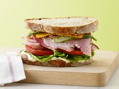 Ultimate Ham Sandwich - Not your everyday deli sandwich, this piled-high beauty is the ultimate between-bread creation. Thick-cut ham makes for a meaty bite, while homemade mayonnaise offers a fresh taste and creamy texture, and dill pickles cut through the richness of the recipe.  Homemade mayo is easily prepared using a blender or food processor.