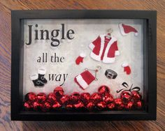 Jingle all the way shadow box: Easy to make - I got all the supplies (shadow box, santa suit, bells, vinyl for the die cutter) at Michaels Craft store.