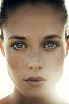 To get a flawless glow without hiding freckles use tinted moisturizer instead of foundation