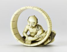 Netsuke of carved ivory, a man sitting within a hoop of short staves and planing the wood, signed: Japan, 19th century