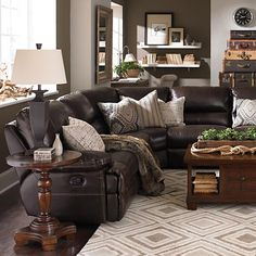Motion Sectional, I love the throw pillows brings the leather couch to a more homey level.