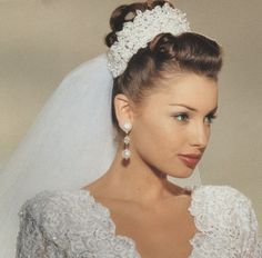 A crown to match the dress. 1990s bridal Ad