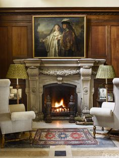 A historic English Estate that combines traditional elements with fresh accents. Somerleyton Hall, a storied English country house built in the century, finds a renewed sense of purpose when a… White Fireplace, Fireplace Design, Country House Design, Wood Panel Walls, Wooden Walls, Oak Dining Table, House Built, Country Estate, Elle Decor