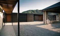 Stone and timber-clad Hilltop Residence integrates with the environment in New Zealand | Inhabitat - Green Design, Innovation, Architecture, Green Building