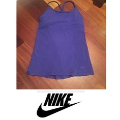 Nike DriFit Racerback Athletic Tank Nike DriFit Racerback tank top. Built in bra. Great condition. No flaws or stains. Nike Tops Tank Tops