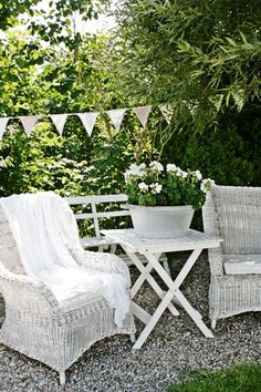 A place to sit, gravel path and simple, white furniture!