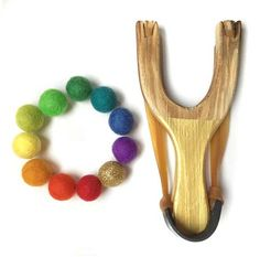 Gold Wooden Slingshot toy with rainbow wool felt ball ammo, Kids Wood Sling Shot, Classic Catapult Toy, glitter felt ball painted handles Wooden Slingshot, Energy Kids, High Energy, Trendy Accessories, Clothing Accessories, Muslin Bags, Kids Wood, Felt Ball