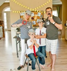 A Vintage Detective Party with a detective's desk dessert table, fingerprint and magnifying glass cookies, chocolate mustaches, mug shot photo booth, crimincal line up game and tons of activities for boys and girls to solve the crime!