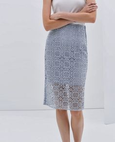 Light Blue Lace Midi Skirt - Zara (pair with white tunic and silver slingbacks, pewter chunky heels and cropped white blouse or shell and navy blazer).
