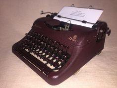 Schreibmaschine Optima Elite kirschrot um 1954 mechanical portable typewriter