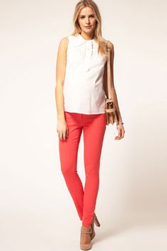 yes, you can wear skinny jeans while pregnant! these adorable coral colored jeans by ASOS prove that.