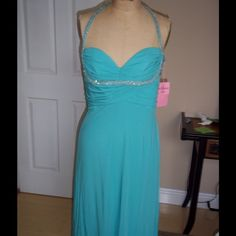 """MISHKA MATTE JERSEY BEADED HALTER DRESS PROM BADGLEY MISHKA MATTE JERSEY BEADED HALTER DRESS SZ 8 PAGEANT PROM RET $575.00  GORGEOUS AQUA COLOR WITH A BEADED HALTER NECKLINE AND BEADED TRIM ruched bodice,zip back flowy bottom and ALL LINED length: 30.5"""" in back 34"""" in front bodice length from top of dress under arms to bottom of ruching: 7.5"""" armpit to armpit across back: 16 1/4"""" waist: 30"""" PERFECT FOR A WEDDING GUEST,BRIDESMAID,PROM OR PAGEANT Badgley Mishka Dresses Midi"""