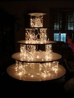 Krispy kreme wedding cake pass out doughnuts and not have a true wedding cake Diy Wedding Cupcakes, Cream Wedding Cakes, Cupcake Stand Wedding, Cake And Cupcake Stand, Wedding Cake Stands, Cupcake Cakes, Cake Stands Diy, Cupcake Stands For Weddings, Wedding Cake With Fountain
