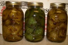 Home made 14 day pickles.  The jar in the middle had 3 drops of green food coloring added before canning.