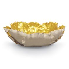 """Ceramic hand-formed tulip leaves finished in gold inside and natural outside form this stunning centerpiece~ 12""""D x 3.5""""H"""