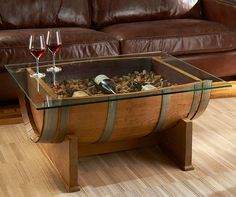 Handcrafted in Italy from half of an authentic reclaimed French wine barrel that can be filled with corks, wine bottles, seasonal decor, or whatever you want and a display glass top to keep your various remote controls and wine glasses from falling in.