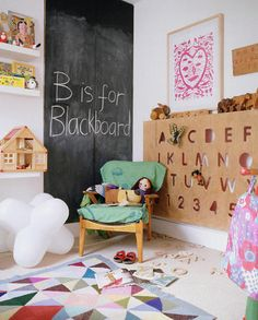 I suspect the cut alphabet shelf is a DIY project in this kids room, but it would be so great to be able to buy one!
