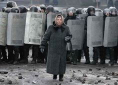 Incredibly Badass Photo Of An Old Woman Walking Through The Ukrainian Riots - BuzzFeed News