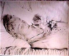 Blonde with corsage in casket 1950s?