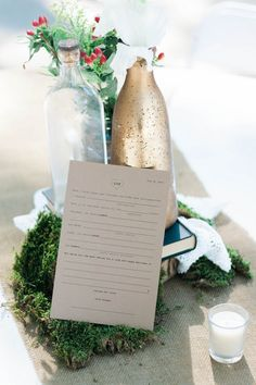 painted bottle centerpiece, photo by Erica Houck Photography http://ruffledblog.com/rural-california-wedding #weddingideas #centerpieces