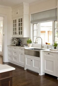 Love the look of this Kitchen. I think we will do this look for our kitchen remodel on our flip house. Will make the small kitchen look so much bigger. More