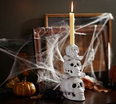 Set the mood for All Hallow's Eve with our stacked skull candle holders.