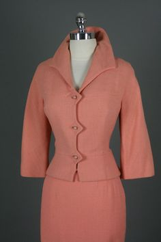 the collar & detailing  around the buttons...
