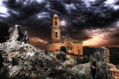 A house and a church stand in ruin after battles during the Spanish Civil war in 1938.  I adore this photo!