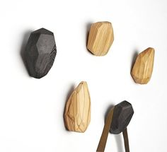 Neutral-toned wooden wall hooks. I love the way the grain shows up under the ash stain.