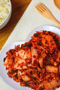 Easy, Authentic Kimchi. The ultimate Korean side dish. Perfect for Kimchi Stew, Fried Rice or on it's own with a bowl of steaming rice. Visit for recipe, quick video and more...